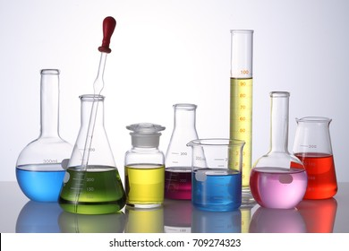 Clean laboratory glassware on white background