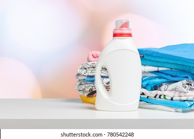 Clean laundry and liquid washing detergent front view