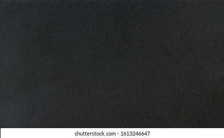 Clean matte dark metal background close up view