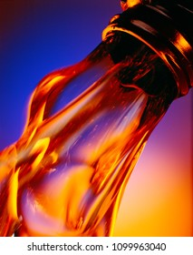 clean motor oil, flowing out of a bottle,colorful background
