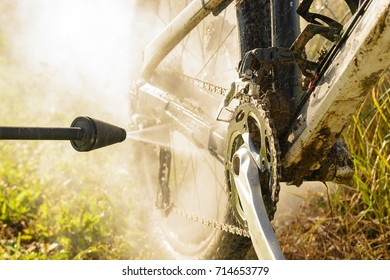 Clean mountain bike with pressure water