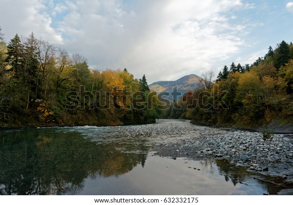 Clean mountain river, autumn forest and mountains at dawn. Caucasus. Russia. The Caucasian reserve. Cordon Guzeripl
