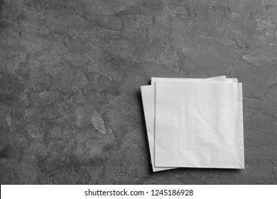 Clean napkins on grey background, top view with space for text
