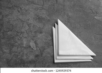Clean napkins on grey background, top view with space for text. Personal hygiene