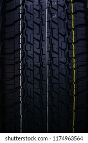 clean new car tyre vertical rubber tire texture pattern background.