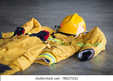 clean and new fireman protection suit and helmet standby on ground at fire station
