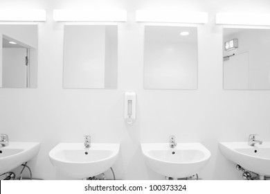a clean new public toilet room empty