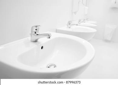 a clean new public toilet room empty
