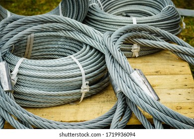 Clean new steel rope wire, coiled steel cable. Industrial equipment