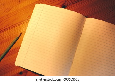 Clean notebook on a wooden table. Template