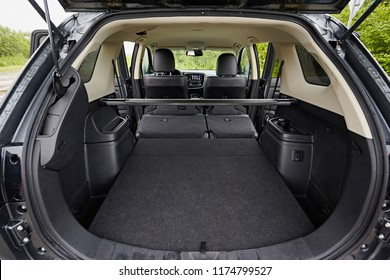 Clean, open empty trunk in the car SUV. Transformation of the seats for carrying luggage in the cabin.