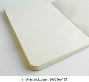 Clean open sketchbook with rounded corners. Mockup with paper notebook