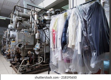 Clean packed clothes hanging in dry cleaning