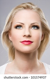 Clean portrait of a beautiful relaxed blond woman in elegant makeup.