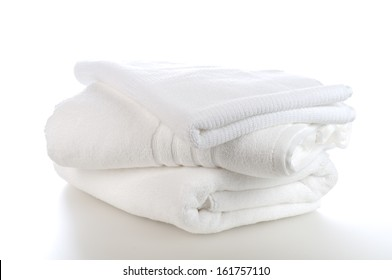 Clean, Pristine White Towels Stacked Isolated on a White Background