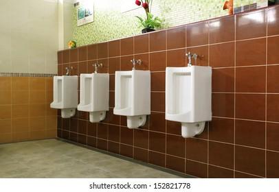 A clean public toilet room empty