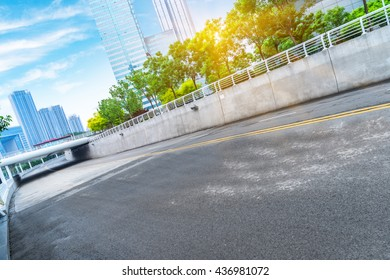 clean road with modern buildings background