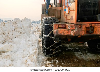 Clean the road in winter with dozer
