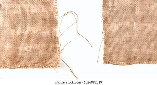 Clean sackcloth fabric worn edges, detail closeup on white background.