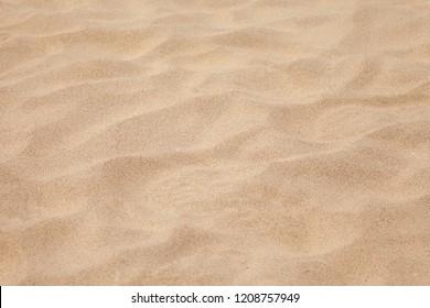 Clean sand texture .Sea tropical sandy beach Summer background .