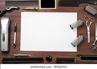 Clean sheet of paper, barber set with equipment and tools on wooden background