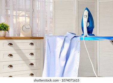 Clean shirt and iron on board indoors
