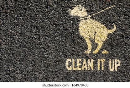 Clean it up sign printed on a path.