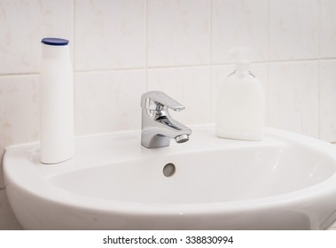 Clean sink and chrome faucet in a bathroom