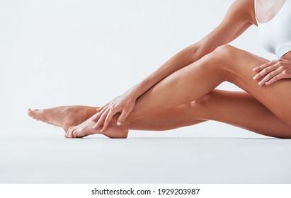 Clean skin. Beautiful woman with slim body in underwear is in the studio.