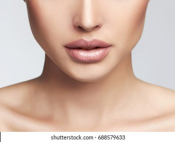 clean skin woman face part.Beauty Makeup Detail.sexy lips.foundation and powdered face