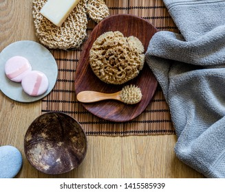 Clean skincare with loofah, dry brush, face exfoliation and solid soap - fresh wash-up shower and zen beauty objects, top view