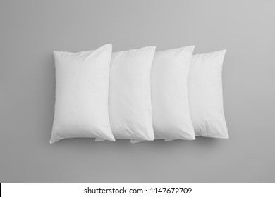 Clean soft bed pillows on grey background, top view