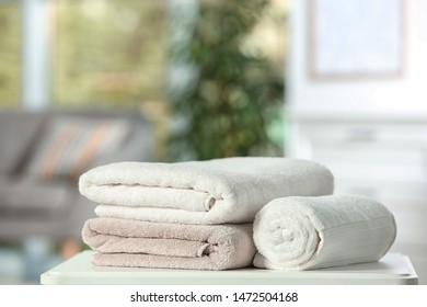Clean soft terry towels on table indoors