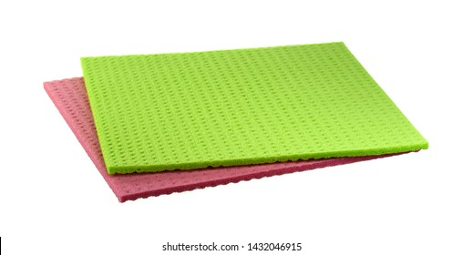 Clean sponge cloths isolated on white background. Household cleaning cloth. Closeup of cleaning rag isolated on a white background.