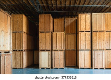 Clean Storage Warehouse with Custom Crates Storage solutions with crates made of wood interior. Logistics and Distribution