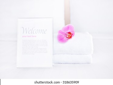 clean towel and empty blank for your text on the bed