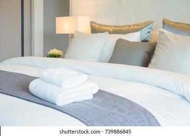 Clean towel on bed in modern interior bedroom