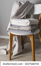 Clean towel on the white chair. Laundry day.