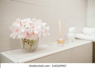 Clean towels,  flowers and Spa bath cosmetic on bathroom