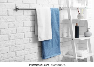 Clean towels on rack in bathroom