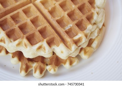 clean waffles on a white plate
