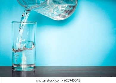 Clean water for good health.  Pouring Fresh Pure Water From Pitcher Into A Glass.  Health And Diet Concept. Lifestyle Healthcare And Beauty.
