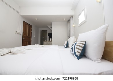 Clean white bedroom, nice view, guesthouse , Accommodation, pillows and blankets, white, white photo frame, white space for text.