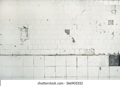 Clean white broken tile wall texture background.