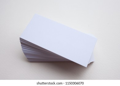 Clean white business cards pile on isolated background, business card empty template