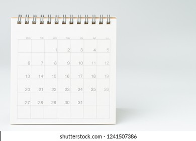 Clean white desktop calendar on white table with copy space, using for schedule appointment or year plan concept.