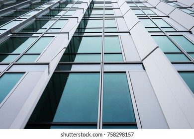 Clean white modern business building  windows closeup from below, converging lines.