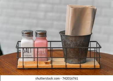Clean white napkins with salt cellar and toothpick.