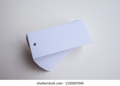Clean white paper shop tags pile on white isolated background, empty business design template example
