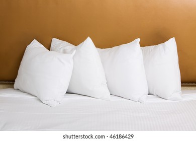 Clean white pillows and sheet on bed